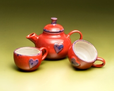 Red teapot and cups