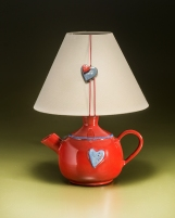 Lighting red teapot